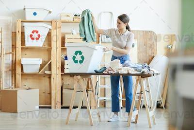 Woman sorting out wardrobe
