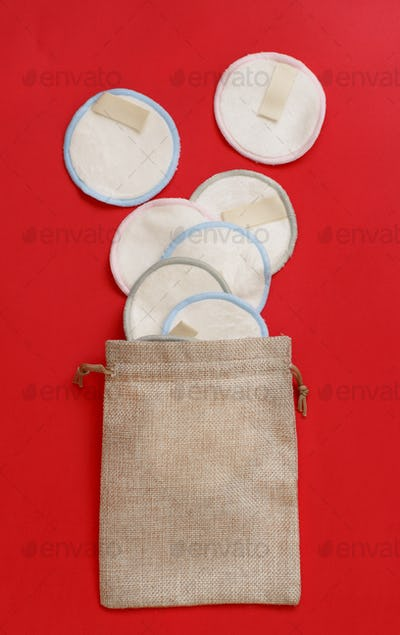 Eco friendly reusable make-up remover pads on red background