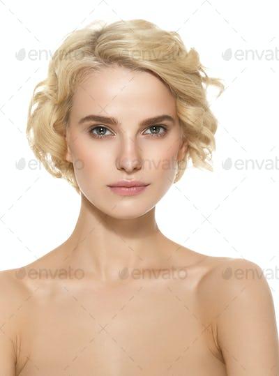 Short Curly Hair Woman Blond Hairstyle Natural makeUp. Studio shot.