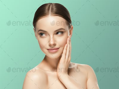 Woman face beauty hand touching face  healthy natural makeup  female blue background