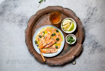Latin American Italian dish Crudo de Salmon Raw Salmon fish platter marinated in lemon juice and