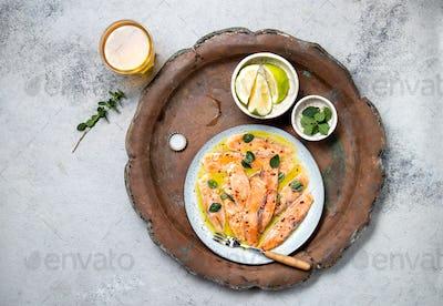 Latin American Italian dish Crudo de Salmon Raw Salmon fish platter marinated in lemon juice and