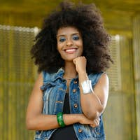 Young beautiful African woman with Afro hair outdoors