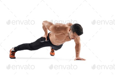 Man doing plank exercise on one hand