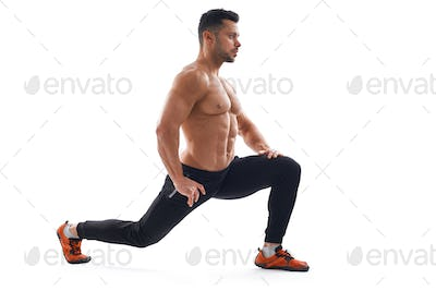 Shirtless bodybuilder stretching, isolated on white