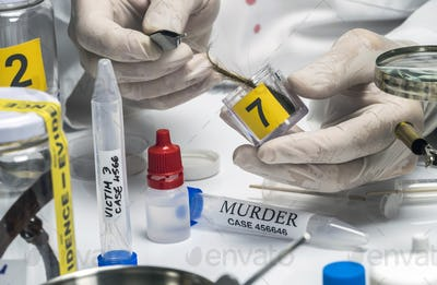 Specialized police analyzes hair of murder victim with a tweezers, conceptual image