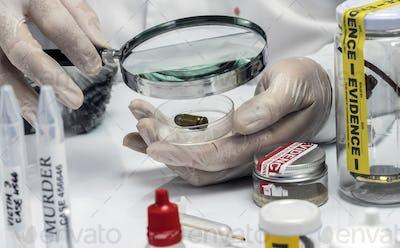 Scientific police examining a bullet cap in ballistic Laboratory, conceptual image