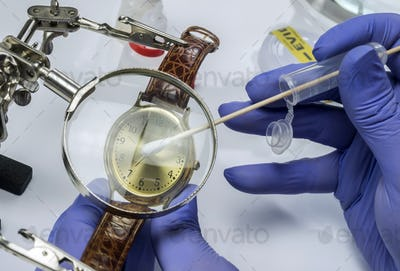Police scientist working in Criminalistic Lab, victim clock analysis for murder, conceptual image