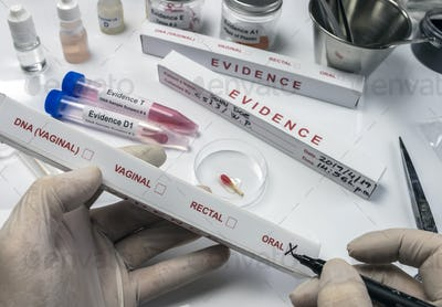 Specialized criminal police check box for oral DNA evidence in an evidence box, concept image