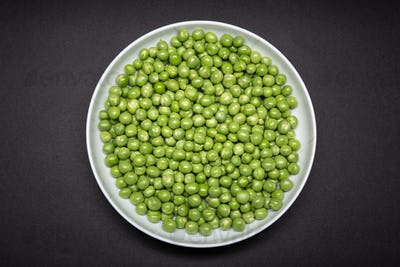 Top view of a plate with fresh Green pea