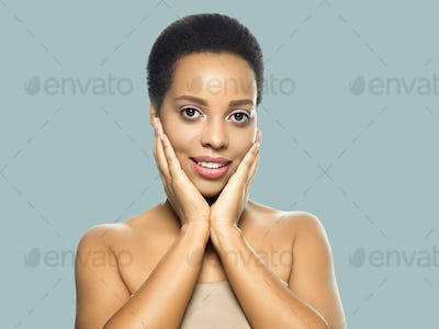 Black skin beauty woman healthy hair skin close afro american beautiful model with hands. On gray.