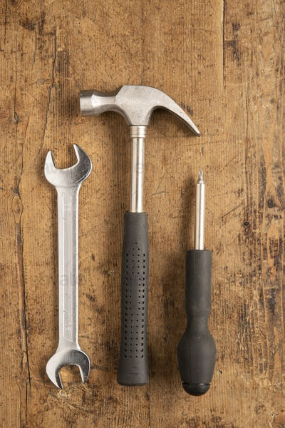 Hammer, cutting plier, screwdriver and a wrench key