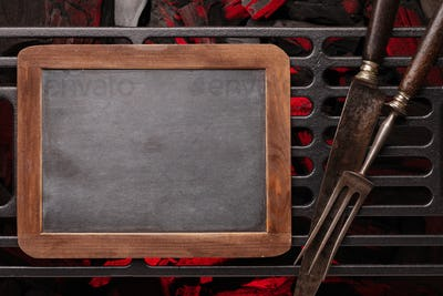 Chalkboard over barbecue grill