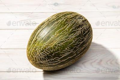 Fresh Muskmelon isolated on white wooden background