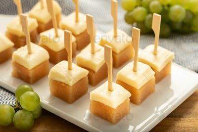 Cheese with jelly quince on tray.