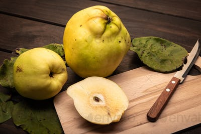 Fresh Quince fruit on wooden table