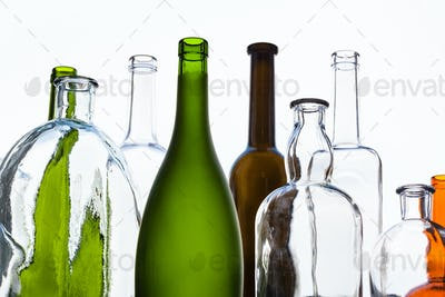 various empty bottles and view of sky in window