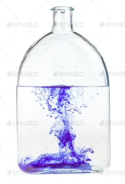 violet watercolour dissolves in water in flask