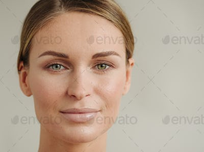 Woman natural beauty casual lifestyle portrait beautiful face. Closeup view.