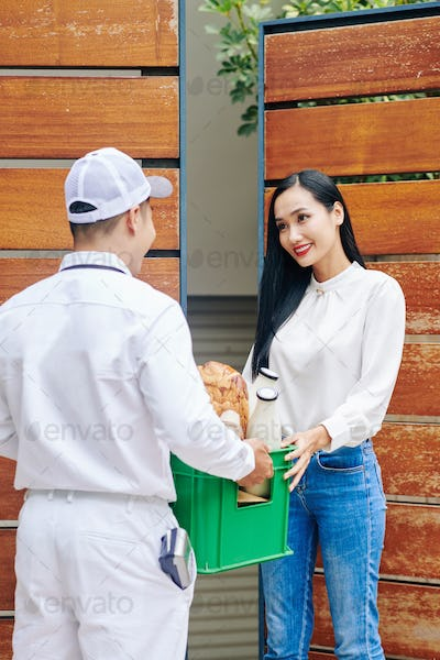 Woman Getting Food Delivery