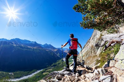 Hiker takes a rest observing a mountain panorama. Mont Blanc