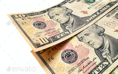 Banknotes of ten american dollars on white background