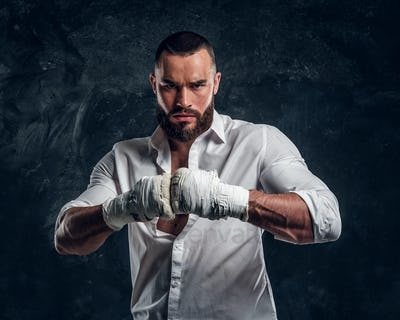 Portrait of cheeky bearded man with boxing gloves