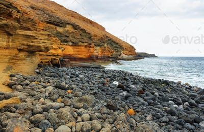 The Yellow Mountain on the ocean shore in Tenerife, Canary islands, Spain