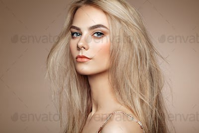 Portrait of beautiful young woman with blonde hair