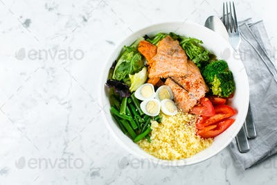 Tuna lunch bowl. Salad with green mix, vegetables, tuna and seeds. Healthy food concept.