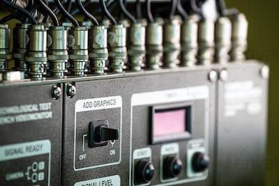 Closeup green panel of television equipment