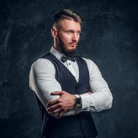 Elegantly dressed young man in a vest with bow tie
