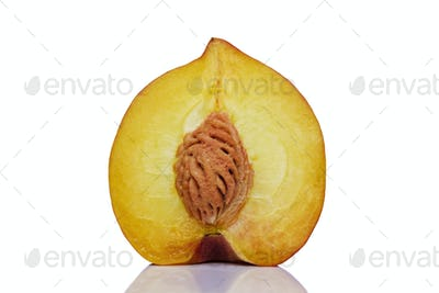Sliced halved peach showing the pip