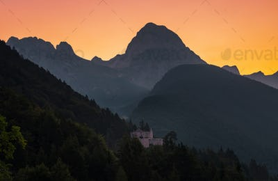 Castle below the Mangart mountain at sunrise