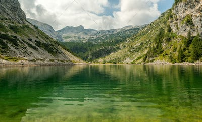 Krn lake reflections on a summer day