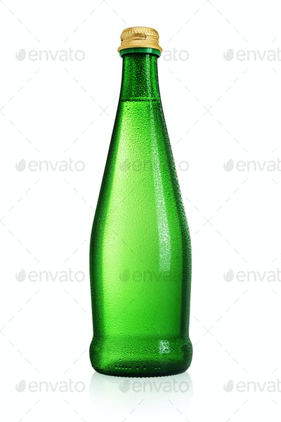 Green glass bottle mineral water without label isolated on white background.