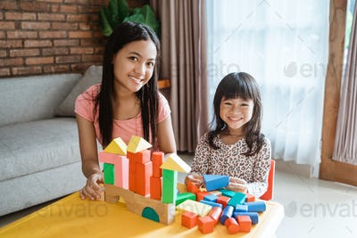 sibling sister play with blocks