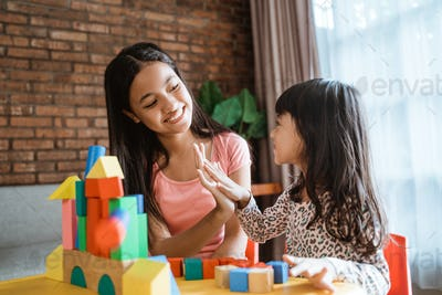 sister play with blocks puzzle