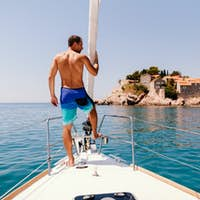 handsome man relax on yacht boat with island view