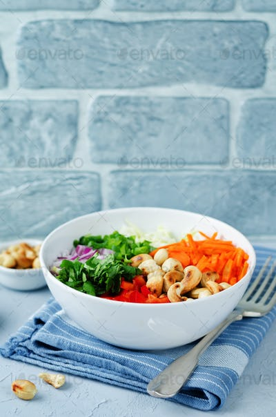 Cabbage carrot red bell pepper cashews salad