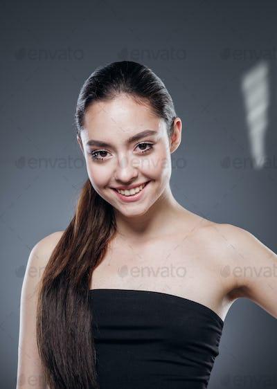 Beautiful hair woman brunette smooth hairstyle dark background