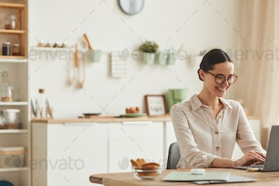 Smiling Young Woman Working from Home
