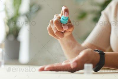 Woman Spraying Hand Sanitizer Close Up