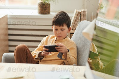 Boy Playing Mobile Games