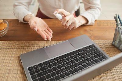 Businesswoman Using hand Sanitizer Close Up