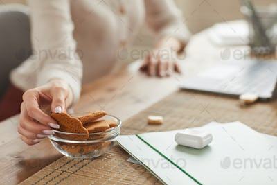 Woman Enjoying Homemade Cookies at Work