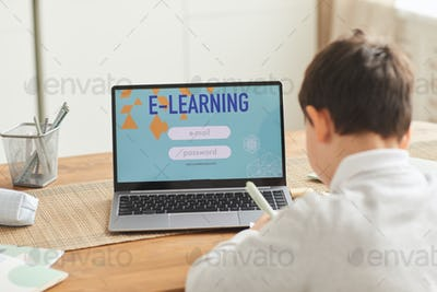 Boy Studying at Home via E-Learning Website