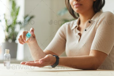 Mixed-Race Woman Sanitizing Hands