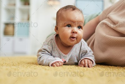 Cute Mixed Race Baby Crawling on Floor