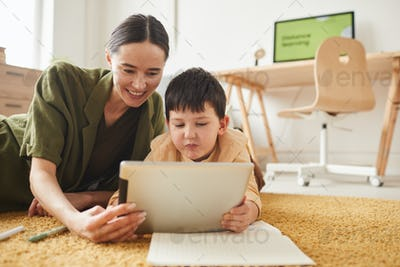 Mother and Son Using Tablet Together